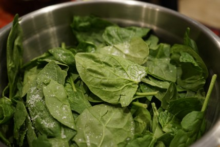 I always start with a base of fresh baby arugula or baby spinach.