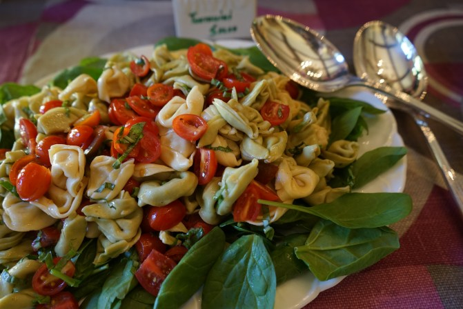 Tortellini Salad with Spinach, Cherry Tomatoes and Lemon Dressing.