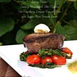 Creamy Horseradish Filet Mignon with Hot Raspberry Dressed Broccoli Rabe and Sugar Plum Tomato Saute`