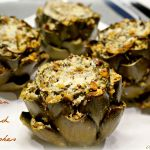 Italian stuffed artichokes are a delicious baked artichoke appetizer. Fresh artichokes are stuffed with fresh herbs, Parmesan cheese and breadcrumbs, then baked until golden.