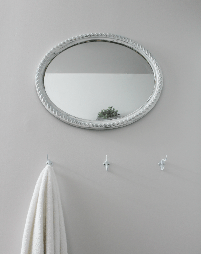 white mirror and hooks