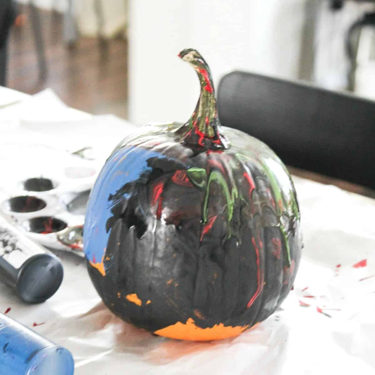 kid painted pumpkin