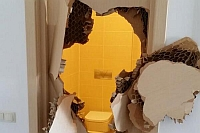 Soci 2014: Un olimpic american a ramas blocat in toaleta