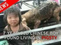 Un baiat de 7 ani din China a fost gasit locuind intr-o cocina de porci