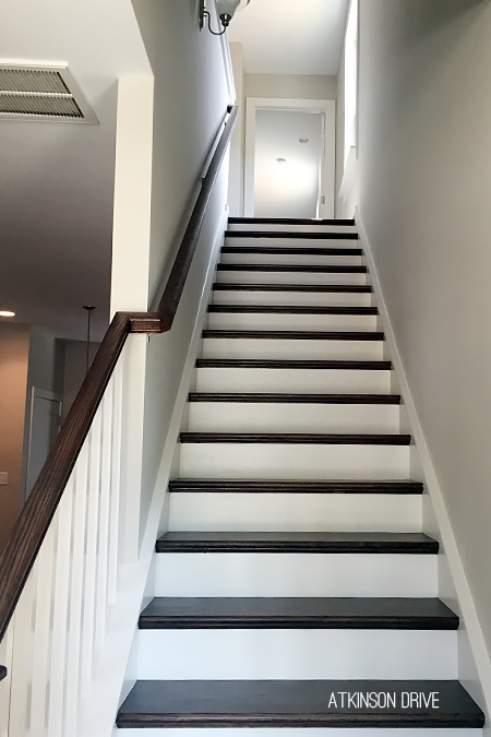 New Home: Dark wood stairs with white risers and craftsman style trim pieces