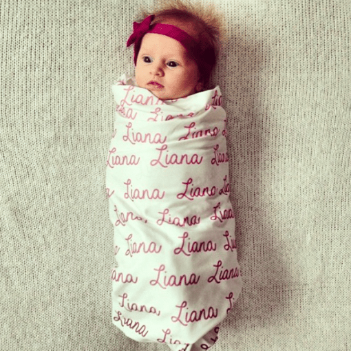 This simple organic cotton baby name swaddle is the perfect way to personalize your little one's room. Use them for swaddling, coming home from the hospital, and milestone photos!