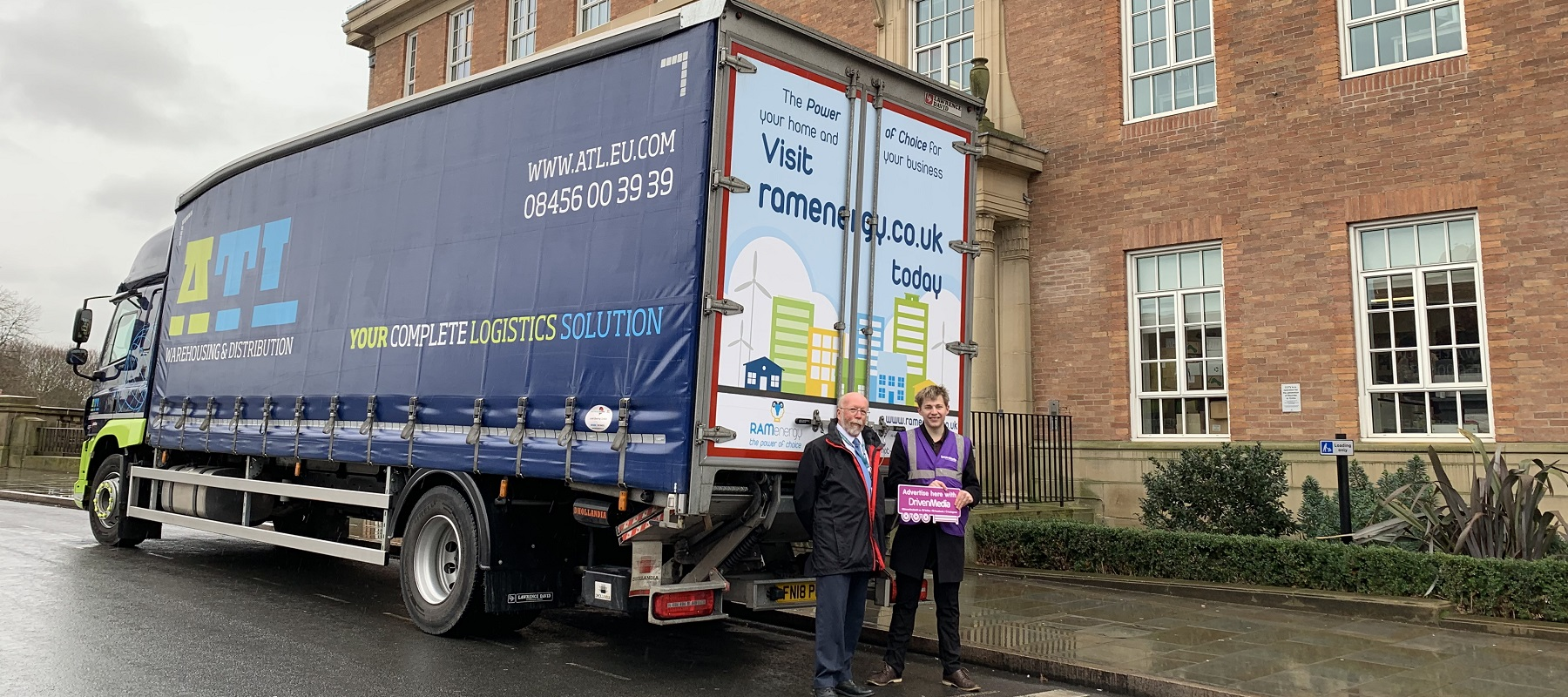 Councillor Roy Webb and Ed Hollands with an ATL lorry to launch RAM Energy