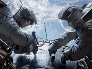 Sandra Bullock as Dr. Ryan Stone and George Clooney as Matt Kowalsky in Gravity