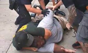 Officer stripped of gun and badge after chokehold death