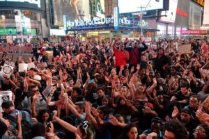 demonstrators in New York shut down Time Square