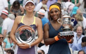 Jun 8, 2013; Paris, France; Serena Williams (USA), right, and Maria Sharapova (RUS) pose with their trophies after their match on day 14 of the 2013 French Open at Roland Garros. Mandatory Credit: Susan Mullane-USA TODAY Sports