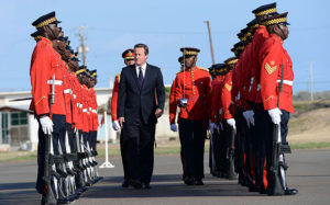 Prime Minister David Cameron inspects a Guard of Honour as he arrives at the airport in Kingston, Jamaica Photo: Photo: Stefan Rousseau/PA Wire