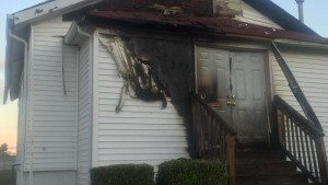 The damage sustained at New Life Missionary Baptist Church by a fire, the fifth black church in the area to be hit by arson in 10 days.