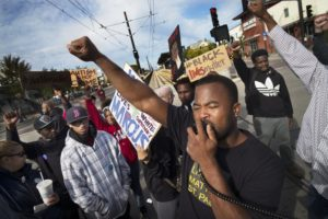 Near the Lexington light rail station in St. Paul, protesters with Black Lives Matters blocked traffic to and from TCF Stadium on the home opener for the Vikings. Organizer Rashad Turner, front, led the event. RICHARD TSONG-TAATARII – STAR TRIBUNE