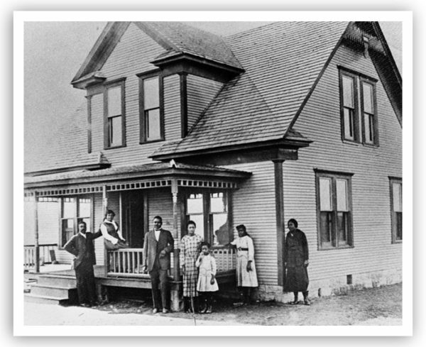 A group of people stand outside a Boley home. Date unknown.