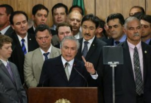 Michel Temer and his new cabinet ministers. Photograph by Bloomberg Bloomberg via Getty Images