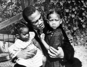 Black Muslim activist Malcolm X with his daughters Qubilah (L) and Attilah (R). (Photo by Robert L. Haggins//Time Life Pictures/Getty Images)