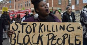 """Baltimore protesters demanding """"Justice for Freddie Gray"""". (Photo courtesy of Ryan Harvey)"""