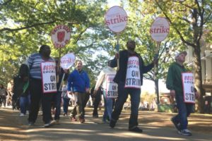Food service workers march Wednesday on Harvard University's campus, marking the first strike on the Ivy League campus since 1983. Photo by Steven Porter.