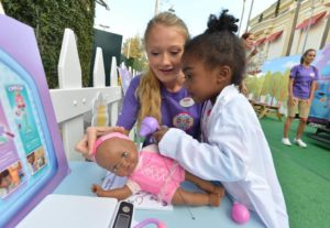 A young girl participates in Doc Mobile interactive tour (Disney Junior/Todd Wawrychuk/Disney/ABC Television Group Flickr/)