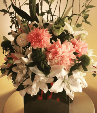 """Ever the dotinghusband, Martin surprised his wife with a mixed arrangement to celebrate the first day of filming on season 2 of Campbell-Martin's series, """"Dr. Ken."""" (@tishacampbellmartin/Instagram)"""