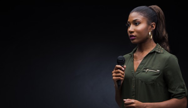 Woman with mic with black background
