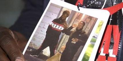 Lanyard with photos of slain man
