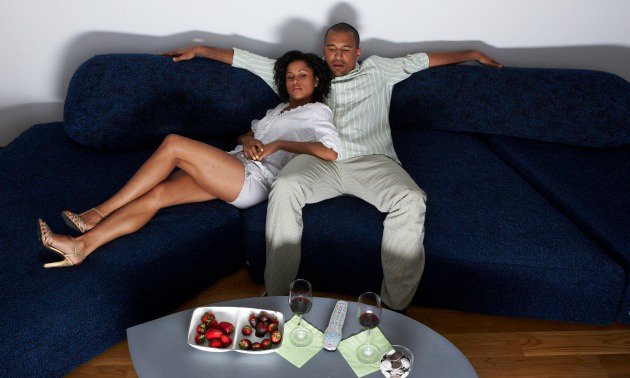 black couple watching tv