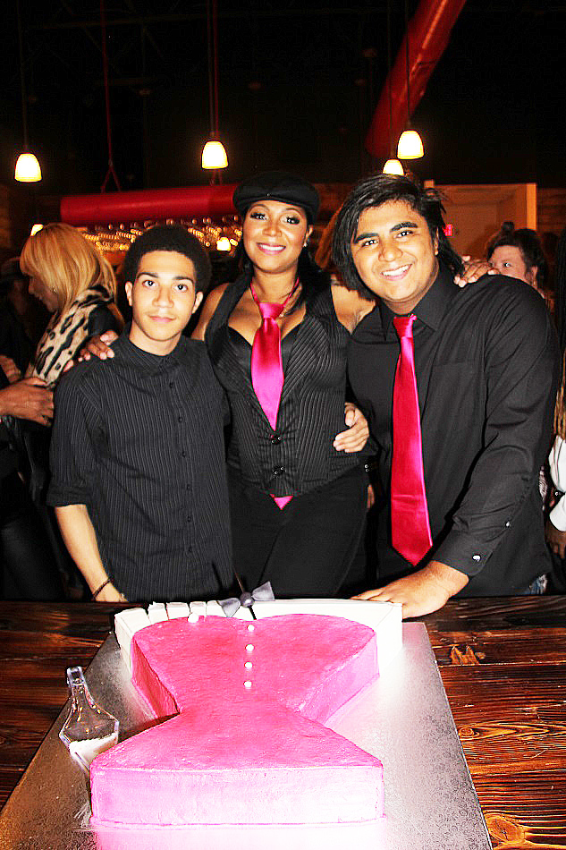 Trina Braxton and her two sons inside Bar-Chix boutique restaurant near Atlanta. (Photos by Terry Shropshire for Atlanta Daily World and Real Times Media).