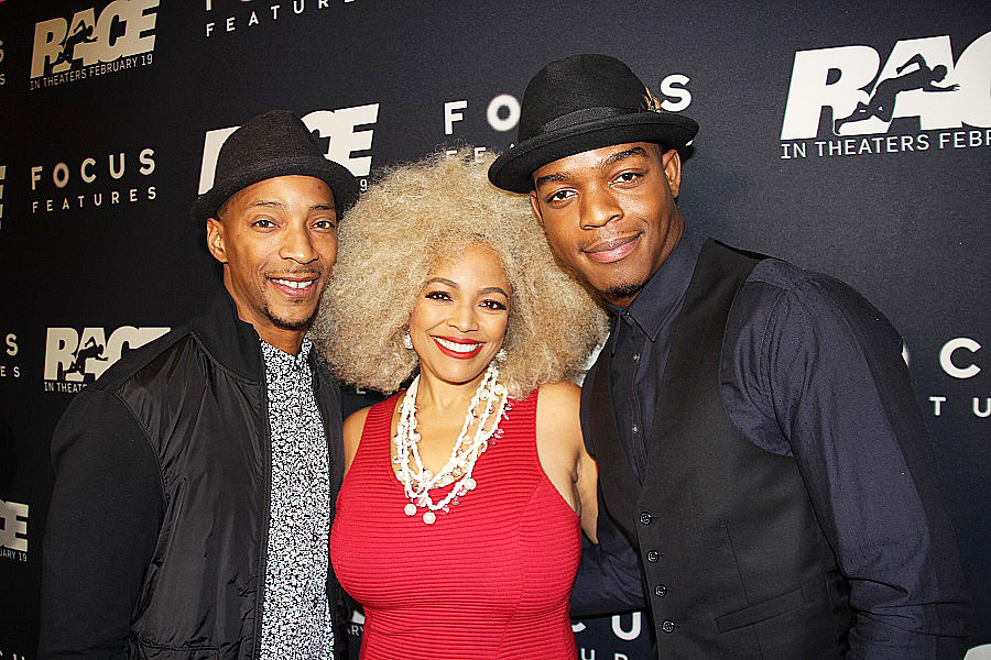 """Kim Fields is sandwiched by her husband Christopher Morgan, left, and """"Race"""" star Stephan James."""