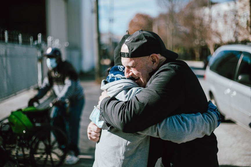 Pastor Paul hugging Man at Atlanta Dream Center church