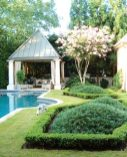"""""""This landscape is the perfect mix of ancient tradition and contemporary accents,"""" says garden designer Marcia Weber of Marcia Weber - Gardens to Love. """"Buckhead is a traditional place and this is a southeast deciduous forest we live in, so you can't totally negate that. But if you pull in a few exotic elements that mix in with our climate, it works. It's not a modern house, nor is it an Asian house, but we've incorporated those elements with this landscape. All of this is a distillation of gardening work and travels from many parts of the globe."""""""