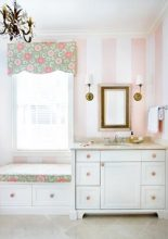 Designing a child's bath doesn't have to involve dinosaurs or pink ponies. Case in point: This charming girl's bathroom at the home of Bonneau and Jennifer Ansley was inspired by the playful yet sophisticated floral fabric. An inviting window seat—with storage below—gives the young occupant a place to stash bath toys now; later, it will hold just as much appeal, providing the perfect place to sit down to slip on a pair of heels. Gwyn Duggan Design Associates, (912) 341-0440