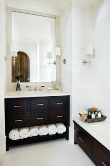 The most intriguing designs are often the result of unexpected touches. Mosaic tiles in the spacious shower create theillusion of three-dimensional architectural details. Meanwhile, rectangular leather tiles mounted on the walls of this bathroom exude an appropriately clean look, especially against the room's dark cabinetry. Summerour Interiors, (404) 603-8585