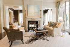 Incorporating pieces from homes they'd fashioned for this client in the past—with an eye to both the present and the future—Stan Topol & Associates created interiors with an evolved look that perfectly suits the family. The formal living room has two separate seating groups, one anchored by a pair of impressive coromandel screens and the other by a mantel from Chesney's.