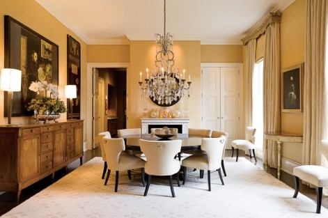The dining room features walls upholstered in Janet Yonaty yellow silk.