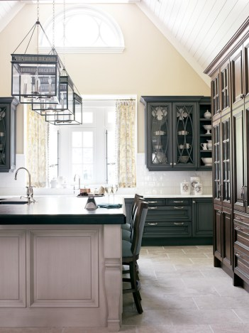 By vaulting the ceiling, architect Linda MacArthur captured a half-round window over the sink and multiplied the natural light that streams into this kitchen. The rays bounce across light and dark finishes in a variety of textures, making the space seem larger in the process—as does the efficient floorplan.
