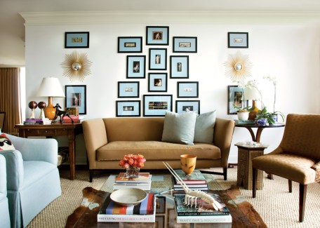 48) Black-and-white images matted in blue create a powerful focal point in the living room of Keith Arnold and Marc Henderson.