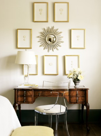 An antique desk, handed down to the designer from her mother, underscores a collection of antique intaglios.