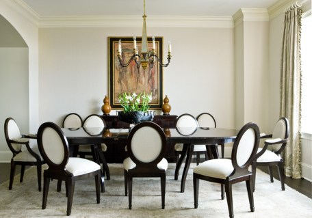 """""""The dining room needed to seat 14, so we found a table that""""s a nice fit on an everyday basis,"""" says Weaks. """"And the owners really responded to the sculptural essence of the Nancy Corzine chairs."""" The furnishings"""" neutral hues allow the room""""s single work of art by Isabelle Melchoir to be the indisputable star."""
