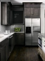 Cabinetry is by Bell Custom Cabinetry. KitchenAid appliances available through Guy T. Gunter & Associates.