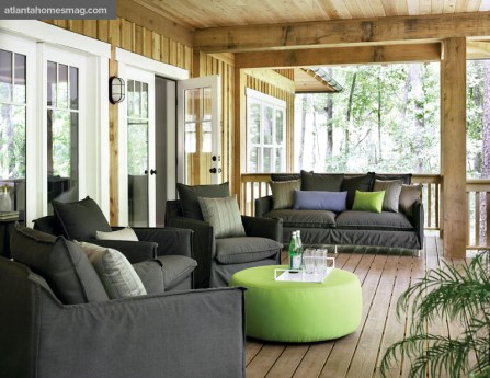 The spacious open-air porch features Room & Board's luxe yet durable outdoor furniture in Sunbrella fabrics.