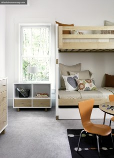 Rooms designated for the home's youngest residents were envisioned with bright pops of color, including miniature orange plywood chairs in a bedroom and green Eames chairs in the sun-soaked craft room.