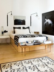"The inspiration for the master bedroom's color scheme came from a vintage Kars rug dating back to the 1930s or '40s. ""I love the feminine pattern as well as the stronger, cream-and-black palette, which is very rare in an old rug,"" says the designer. Rug, Sullivan Fine Rugs. Bedside tables, Belvedere."