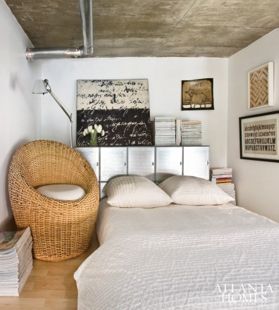 The loft above Hanson's kitchen was originally her art studio but has since evolved into a sleeping space.