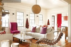 Against a backdrop of white, Douglass introduced bold and graphic pops of orange, purple and fuschia in the living room of her Lake Rabun vacation home. Basket light, pillows and Verellen sofas and chairs, South of Market. The leather chaise was bought in France.