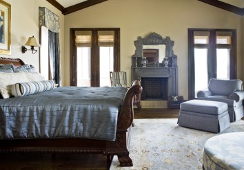 "The master bedroom, designed in calming blue tones, opens to a screened-in porch, which overlooks both the lake and a garden full of ""Monica"" rose bushes."