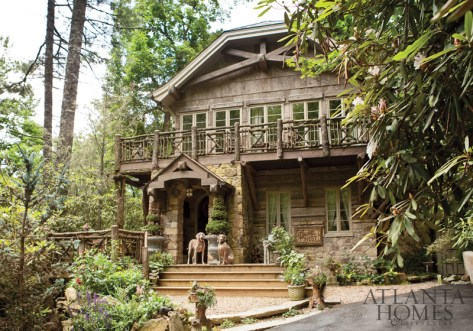 Homeowner Bill Cook and architect Michael Faust created Laurel Nest from a mix of architectural styles from across the Appalachian region, as well as from details reminiscent of antique storybook illustrations. Cook's Weimaraners, Ethyl and Sprocket, await guests near the front entrance.