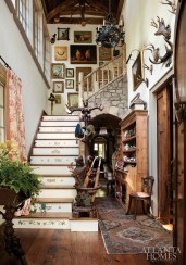 The Goldilocks and the Three Bears-inspired newel post was originally a carved-walnut coat rack, and the staircase and laurel railings were built around it.