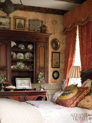 """Cook kept his mother in mind, as well as Little Red Riding Hood's grandmother, when designing the """"lady's guest room."""" From the English antiques to the wallpaper and wainscoting, every inch of the room is embellished."""